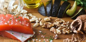 A table is covered with anti-inflammatory foods that are part of an arthritis diet