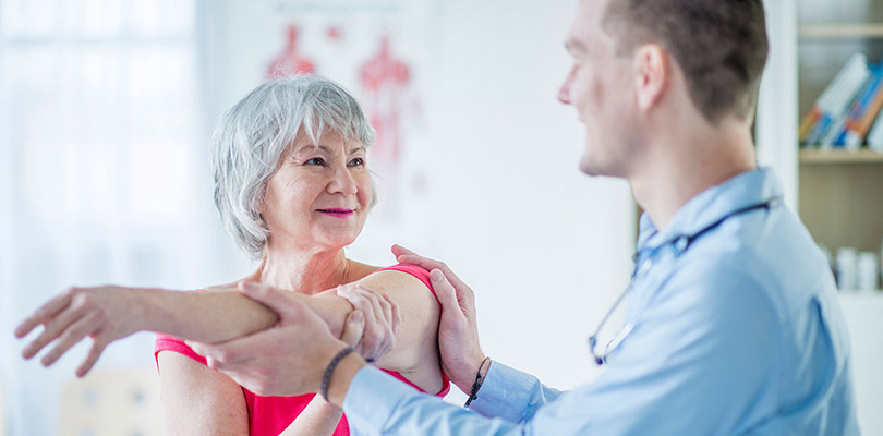 A woman is receiving physical therapy for arthritis pain relief