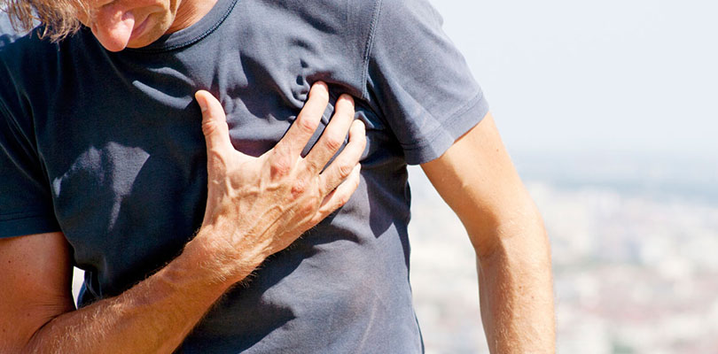 A man who has arthritis is experiencing chest pain