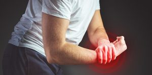 A man is experiencing carpal tunnel syndrome symptoms