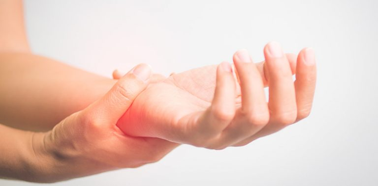 An individual is experiencing carpal tunnel symptoms
