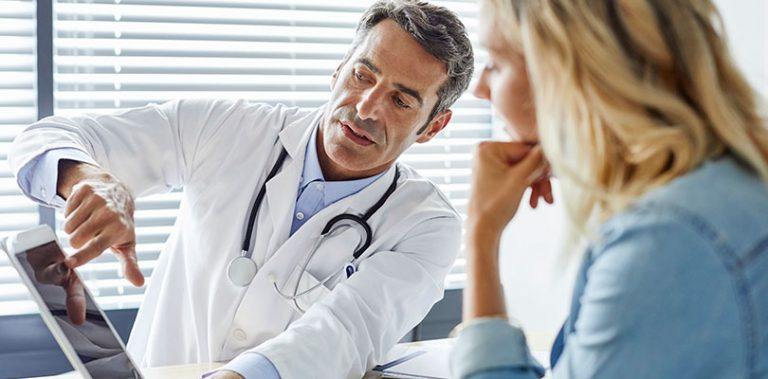 A doctor is explaining a diagnosis to a patient